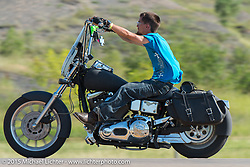 Cruising along Highway 34 during the 75th Annual Sturgis Black Hills Motorcycle Rally.  SD, USA.  August 2, 2015.  Photography ©2015 Michael Lichter.