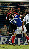 FULHAMS's keeper TONY WARNER grabs AZAR KARADAS by the throat. KARADAS was the one that received a  booking<br /> <br /> PORTSMOUTH V FULHAM PREMIERSHIP 31.12.05 <br /> <br /> PHOTO SEAN RYAN FOTOSPORTS INTERNATIONAL
