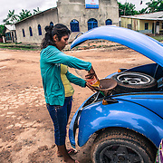 "Tabatinga, Amazonas, Brazil. Judith comes from Iquitos, Peru. She sells gasoline on the streets of Tabatinga, on the Brazilian side of the border. ""Life conditions are much better here on this side of the border"", she says."