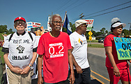 Robert Taylor  leading a Coalition Agianst Death Alley march in St. John the Baptist Parish  on May 30, 2019- the first strech of a planned five day event.