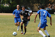 Jose Ceballos of Deportivo Colomex drives the ball forward against Team Shlama F.C. during National Soccer League play in Skokie, Il.