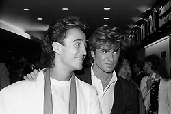 File photo dated 08/10/84 of Wham's Andrew Ridgeley and George Michael (right). Pop superstar Mr Michael has died peacefully at home, his publicist said.