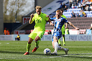 Adam Thompson of Southend United is tackled by David Perkins of Wigan Athletic (r). Skybet football league one match , Wigan Athletic v Southend Utd at the DW Stadium in Wigan, Lancs on Saturday 23rd April 2016.<br /> pic by Chris Stading, Andrew Orchard sports photography.