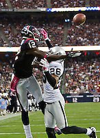 HOUSTON, TX - OCTOBER 9:   Jacoby Jones #12 of the Houston Texans tries to catch a touchdown pass over Stanford Routt #26 of the Oakland Raiders at Reliant Stadium on October 9, 2011 in Houston, Texas.  The Raiders defeated the Texans 25 to 20.  (Photo by Wesley Hitt/Getty Images) *** Local Caption *** Jacoby Jones; Stanford Routt Sports photography by Wesley Hitt photography with images from the NFL, NCAA and Arkansas Razorbacks.  Hitt photography in based in Fayetteville, Arkansas where he shoots Commercial Photography, Editorial Photography, Advertising Photography, Stock Photography and People Photography