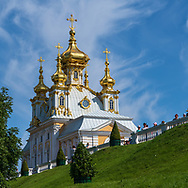 Peterhof, Russia -- July 21, 2019. A photo of gold domed living quarters adjacent to the  Summer Palace in Peterhof.