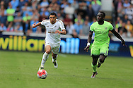 Jefferson Montero of Swansea city (l) breaks past Bacary Sagna of Manchester city Barclays Premier league match, Swansea city v Manchester city at the Liberty Stadium in Swansea, South Wales on Sunday 15th May 2016.<br /> pic by Andrew Orchard, Andrew Orchard sports photography.