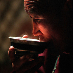 A an 80 year old herder in the central Tov province of Mongolia takes a sip of milk-tea.  Born into a nomadic tradition that has spanned 1,000 years, he may be the last generation to live his entire life as a nomadic herder..