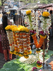 Garlands of flowers on stall in Mumbai.
