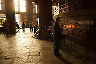 A man prays at Todaji the largest wooden temple in the world. Nara, Japan.