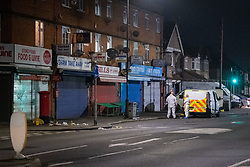 © Licensed to London News Pictures. 11/11/2020. Slough, UK. Blood soaked medical waste sits next to a post box on Stoke Poges Lane as forensic investigators stand next to a police vehicle. A person was reportedly stabbed in Slough on Tuesday 10/11/2020. A large cordon was put in place by Thames Valley Police centred around shops on Stoke Poges Lane and included a large section of Bradley Road. Photo credit: Peter Manning/LNP