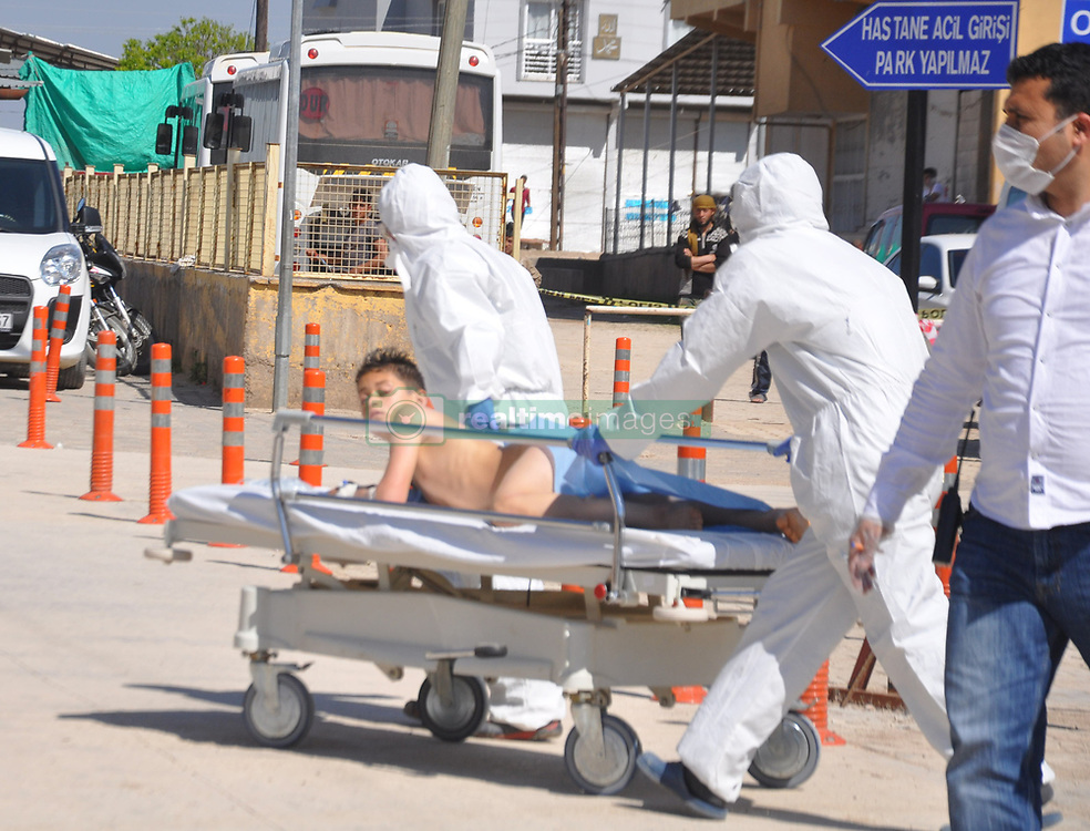 April 4, 2017 - Hatay, Turkey - Men in masks and hazmat suits push a boy to the hospital on a gurney. At least 58 people have been killed and dozens wounded in a suspected chemical attack on a rebel-held town in north-western Syria, a monitoring group says. Around 30 Turkish ambulances gathered at the border in Hatay province for medical evacuation of victims after Syria toxic gas attack, to be brought to Turkey. (Credit Image: © Ferhat Dervisoglu/Depo Photos via ZUMA Wire)