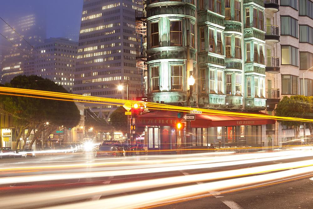 San Francisco, California, United States - Light trails on Kearny Street and Columbus Avenue in San Francisco.