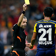 Referee's Cuneyt Cakir show theyellow card to Fenerbahce's Selcuk Sahin during their Turkish superleague soccer derby match Galatasaray between Fenerbahce at the AliSamiYen spor kompleksi TT Arena in Istanbul Turkey on Saturday, 18 october 2014. Photo by Aykut AKICI/TURKPIX