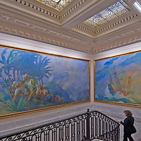 Paintings of classic exploration overhang the stairs leading to the formal boardroom at the National Geographic headquarters in Washington, DC.  (Expeditions Council Director Rebecca Martin is descending the stairs after the Council's 2011 Board meeting.)