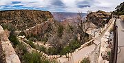 Guarding the entrance to the Bright Angel Trail is the restored 1905 Kolb Studio, in Grand Canyon National Park, Arizona, USA. This historic studio documents the amazing lives of photographer brothers Ellsworth and Emery Kolb. This image was stitched from multiple overlapping photos.