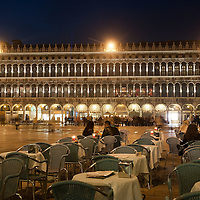 VENICE, ITALY - MARCH 31:  Tourists sit at an outside table at a cafe in St Mark's Square few seconds ahead before the lights are switched off for Earth Hour 2012 on March 31, 2012 in Venice, Italy. According to organizers, Earth Hour 2012 has participants including individuals, companies and landmarks in 147 countries and territories and over 5,000 cities agreeing to switch off their lights for one hour. The Brandenburg Gate, the Eiffel Tower in Paris, Big Ben Clock Tower in London, the Christ the Redeemer statue in Rio de Janeiro and the Empire State Building in New York are among the monuments whose operators have agreed to participate in the demonstration.  (Photo by Marco Secchi/Getty Images) San Marco is one of the six sestieri of Venice, lying in the heart of the city.