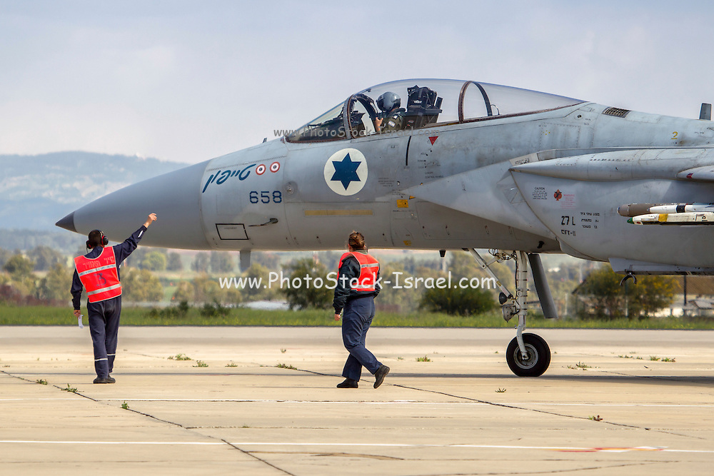 Israeli Air force (IAF) Fighter jet F-15 (BAZ) on the ground Close-up of the pilot in the cockpit. Ground crew in the foreground