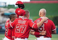 The Angels' Erick Aybar knocks Mike Trout's hat off next to Albert Pujols before the start of the Halos' 5-2 victory over the Colorado Rockies Tuesday night at Angel Stadium.