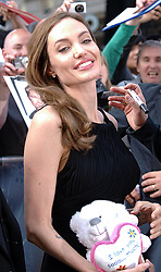 Angelina Jolie holds a cuddly toy she was given as she arrives for the World War Z UK film premiere at The Empire, Leicester Square, London, United Kingdom, <br /> Sunday, 2nd June 2013<br /> Picture by Max Nash / i-Images