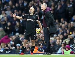 West Ham United's Pablo Zabaleta (left) talks to manager David Moyes on the touchline during the Premier League match at the Etihad Stadium, Manchester.