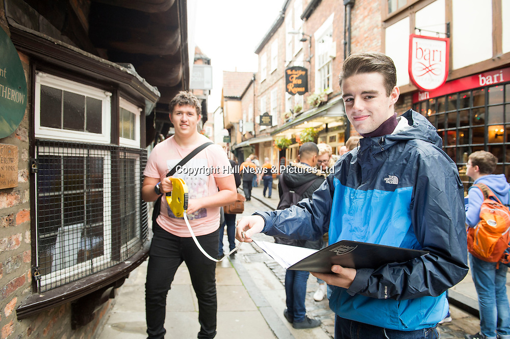 7 October 2016: Tollbar MAT Sixth Form College students visiting to York as part of thier Geography A Level studies.<br /> (l-r) Matthew Clayton and Tom Hughes measuring shop fronts on The Shambles.<br /> Picture: Sean Spencer/Hull News & Pictures Ltd<br /> 01482 210267/07976 433960<br /> www.hullnews.co.uk         sean@hullnews.co.uk