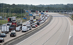 © Licensed to London News Pictures. 11/07/2019. London, UK. Traffic builds up anti-clockwise between junctions 9 - 10 on the Surrey stretch of the M25 after a lorry crashed earlier this morning. The west bound carriage way is closed causing long tailbacks. A man was flown to hospital in an air ambulance.   Photo credit: Peter Macdiarmid/LNP