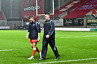 Rugby Union - 2020 / 2021 Heineken Cup - Pool 1 - Scarlets vs Toulon - Parc-y-Scarlets<br /> <br /> Scarlets Scarlets players leave the field in torrential rain after the match was called off at the last minute, not on account of the weather conditions, but on account of covid 19 concerns from Toulon<br /> <br /> <br /> COLORSPORT/WINSTON BYNORTH