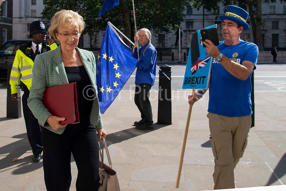 Pro remain campaigner Steve Bray speaks to Andrea Leadsom MP, Secretary of State for Department for Business, Energy and Industrial Strategy as she arrives at the Cabinet office in Whitehall, London, United Kingdom on 22nd August 2019.
