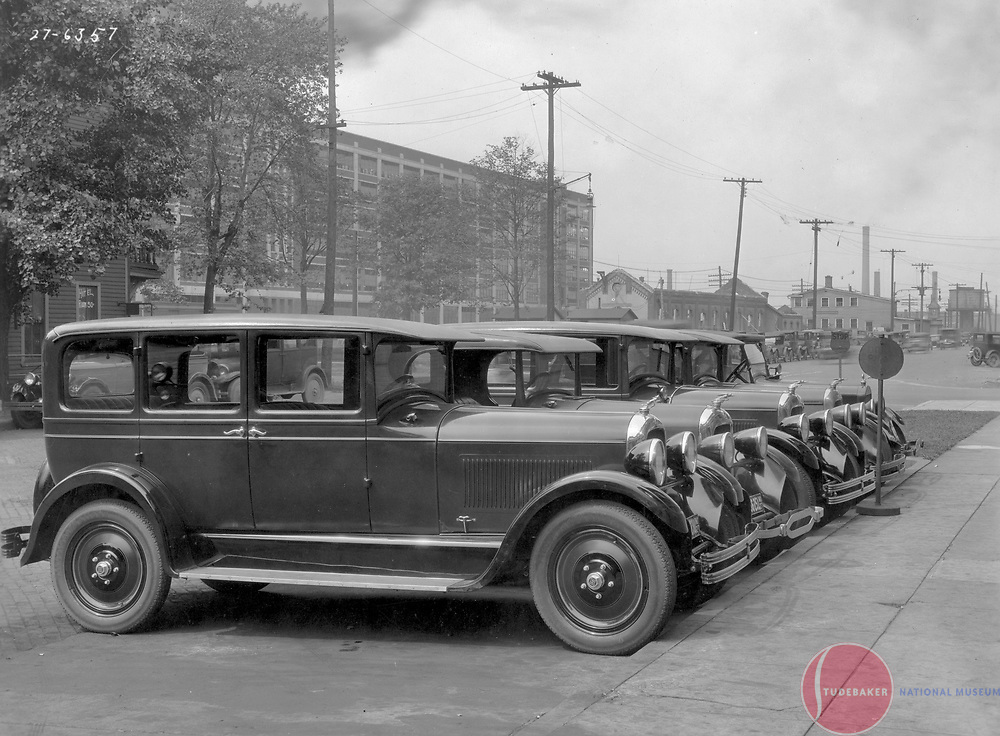 1927 Studebakers on South Street just south of the Scherman-Schaus Freeman/Freeman Spicer building.  Studebaker building #84 is visible in the background, as is South Bend's old train station, under demolition.
