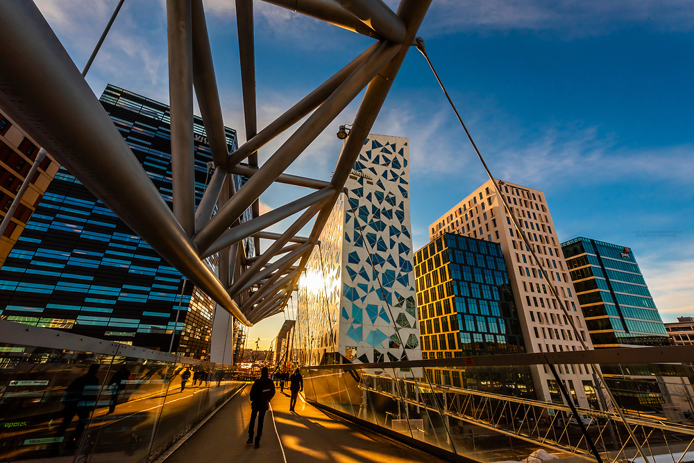 The Acrobat (Akrobaten) pedestrian bridge (designed by L2 Architects), and The Barcode Project is a section of the Bjørvika portion of the Fjord City redevelopment on former dock and industrial land in central Oslo. It consists of a row of new multi-purpose high-rise buildings, that was completed in 2016.  (Masterplan by MVRDV of Rotterdam and the Norwegian firms DARK Architects and A-Lab), Oslo, Norway.