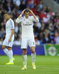 Real Madrid's Gareth Bale adjusts his hair  - Photo mandatory by-line: Joe Meredith/JMP - Mobile: 07966 386802 12/08/2014 - SPORT - FOOTBALL - Cardiff - Cardiff City Stadium - Real Madrid v Sevilla - UEFA Super Cup