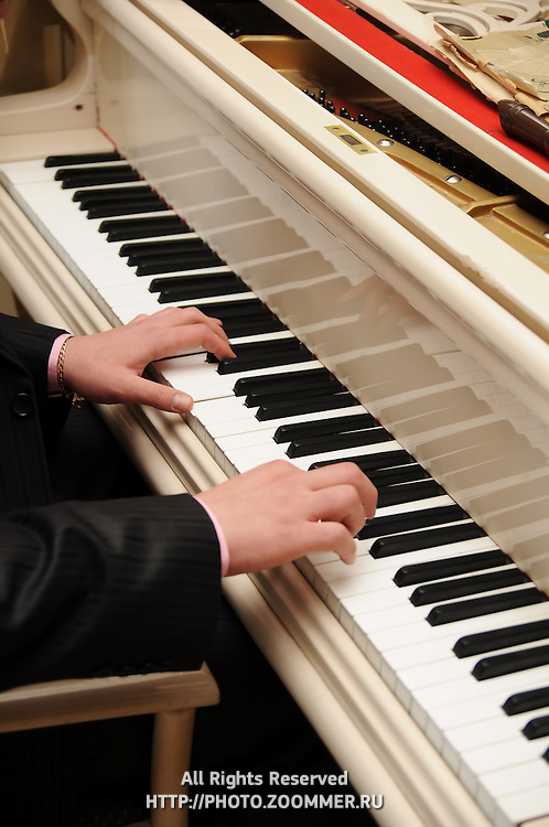 Man's hands playing piano
