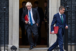 © Licensed to London News Pictures. 12/06/2018. London, UK. Foreign Secretary Boris Johnson (L) and Defence Secretary Gavin Williamson (R) leave 10 Downing Street after the Cabinet meeting. Photo credit: Rob Pinney/LNP