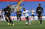Bolton Wanderer's Robert Hall runs through the Wigan defence. Skybet football league championship match , Bolton Wanderers v Wigan Athletic at the Reebok stadium in Bolton on Saturday 29th March 2014.<br /> pic by David Richards, Andrew Orchard sports photography.