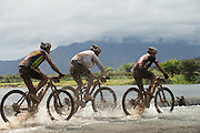 Riders cross the Breede river during stage 2 of the 2014 Absa Cape Epic Mountain Bike stage race from Arabella Wines in Robertson, South Africa on the 25 March 2014<br /> <br /> Photo by Greg Beadle/Cape Epic/SPORTZPICS