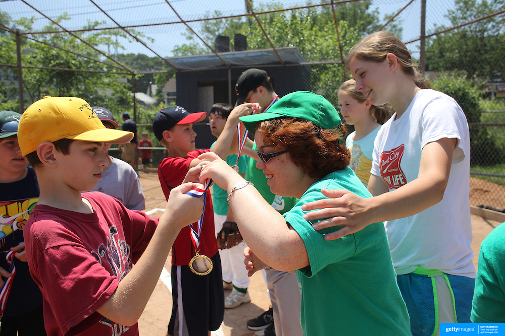 Players are presented with medals during the Norwalk Little League baseball 'Champions' team V Greenwich in the Challenger Division Recognition Day competition. The day acknowledged the many talents of the great players on the Challenger Division teams. The division has weekly games and practices for kids with special needs. Challenger division are held throughout the country.  Broad River Fields, Norwalk, Connecticut. USA. 2nd June 2013. Photo Tim Clayton