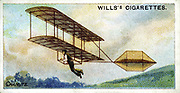 Biplane Glider of Octave Chanute (1832-1910) French-born American engineer. Flight achieved by running downhill until airborne. Chanute and team began experimetns in 1896. From set of cards on aviation published 1910. Chromolithograph.