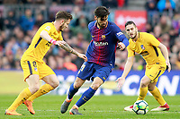 FC Barcelona's Andre Gomes (c) and Atletico de Madrid's Saul Niguez (l) and Koke Resurreccion during La Liga match. March 4,2018. (ALTERPHOTOS/Acero)