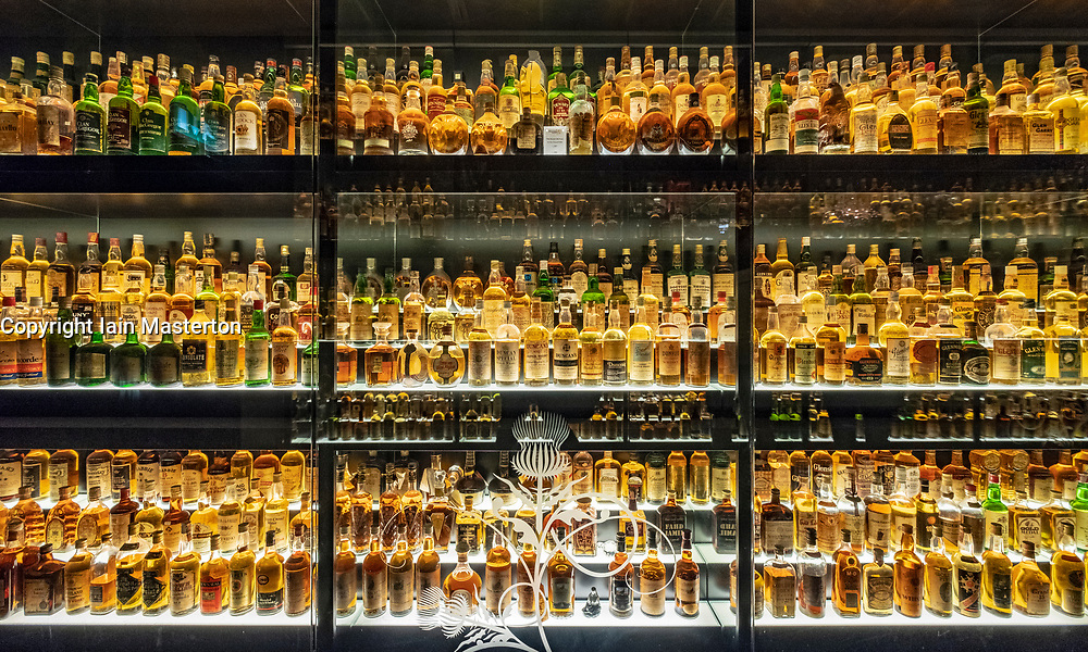 Many bottles of Scotch Whisky on display at the Scotch Whisky Experience visitor centre on the Royal Mile in Edinburgh, Scotland, UK