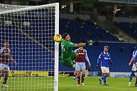 Football - 2020 / 2021 Premier League - Brighton and Hove Albion vs. Aston Villa - Amex Stadium<br /> <br /> Emiliano Martinez of Aston Villa looks on as the looping header from Dan Burn of Brighton beats his outstretched arm and clips the post during the Premier League match at The Amex Stadium Brighton <br /> <br /> COLORSPORT/SHAUN BOGGUST