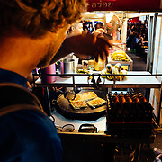 Andrew Whiteford and Jay Goodrich explore the local night market in downtown Chiang Mai, Thailand.
