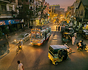 Bus, motorcycle, donkey carts, rickshaws and pedestrians: the evening rush in the Sadar district area.