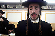 Extremist Haredi Jewish men praying, Lev Tahor (Pure Heart) community, Sainte Agathe des Monts, Quebec, Canada