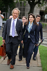 12 June  2015. New Orleans, Louisiana. <br /> L/R Attorney Randy Smith and Rita Benson LeBlanc leave Civil Distrcit Court on the last day of a hearing to determine the competency of grandfather/father Tom Benson. Benson is the billionaire owner of the NFL New Orleans Saints, the NBA New Orleans Pelicans, various auto dealerships, banks, property assets and a slew of business interests. Rita, her brother and mother demanded a competency hearing after Benson changed his succession plans and decided to leave the bulk of his estate to third wife Gayle, sparking a controversial fight over control of the Benson business empire.<br /> Photo©; Charlie Varley/varleypix.com