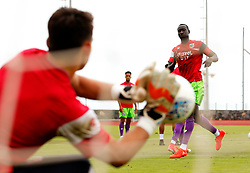 Max O'Leary of Bristol City saves a shot from Famara Diedhiou during the warm up - Mandatory by-line: Matt McNulty/JMP - 22/07/2017 - FOOTBALL - Tenerife Top Training - Costa Adeje, Tenerife - Bristol City v Atletico Union Guimar  - Pre-Season Friendly