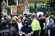London, United Kingdom, June 27, 2021: Some young participants hold placards and banner as they dance and drink during an anti-government musical rave in central London on Sunday, June 27, 2021. (VX Photo/ Vudi Xhymshiti)