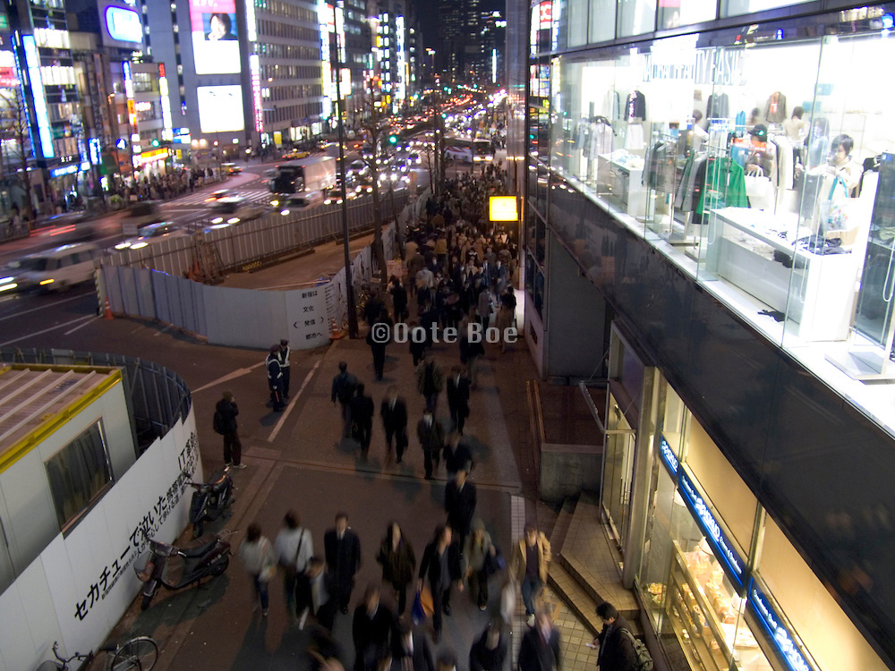 Tokyo by night evening rush hour