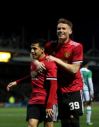 Manchester United's Alexis Sanchez (left) and Manchester United's Scott McTominay (right) celebrate after team-mate Manchester United's Ander Herrera (not in picture) scores his side's second goal of the game during the Emirates FA Cup, fourth round match at Huish Park, Yeovil.