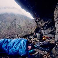TIBET, Tsangpo Gorge, David Breashears wakes to rain in Himalayan cave below Mt.Namche Barwa(porters bkg)