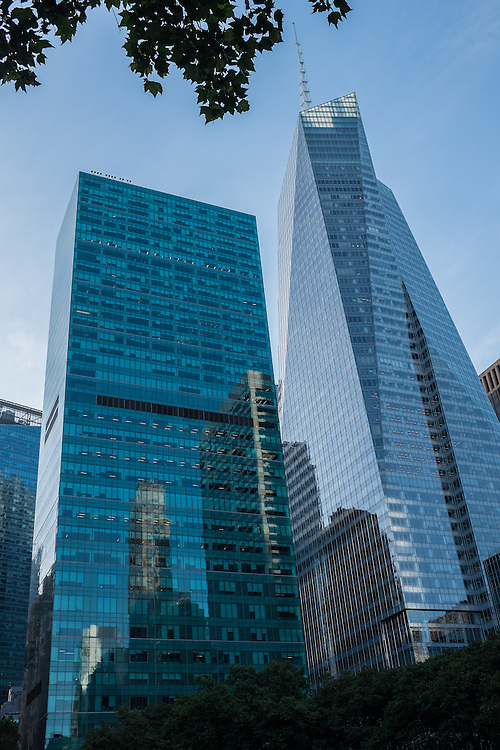 The spire of the Bank of America Tower (right) completed in 2009, and 1095 Sixthe Aenue (left), formerly the Bell Atlantic buildign, byKahn & jacobs, 1970, and with a new glass facade by Moed de Armas & Shannon, 2008. The Bank of American Tower is the world's first LEED Platinum rated skyscraper.